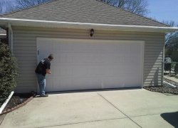Looking at garage door to fix it