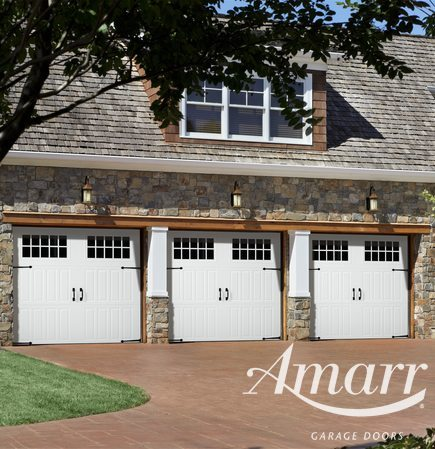 Amarr - Three new carriage style white garage doors