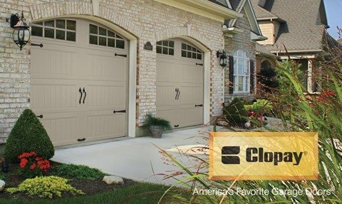 Clopay - Twin, tan garage doors in a Gallery style